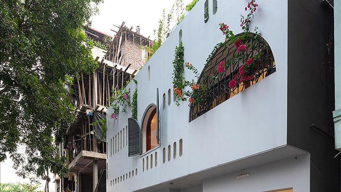 Căn biệt thự trắng có mặt tiền cong độc đáo, nổi bật nhất khu phố ở Hà Nội - 9