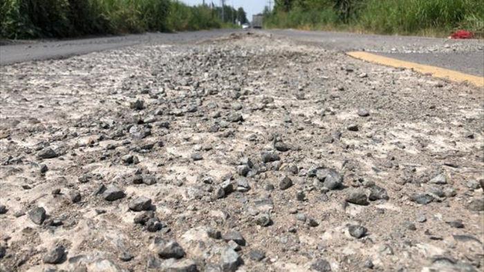 Ảnh: Con đường chỉ dài 2km nhưng có gần 100 'hố tử thần' ở Đồng Nai - 2