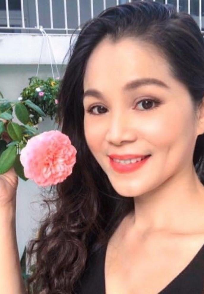 Bà xã doanh nhân U50 kín tiếng của MC Quyền Linh-10