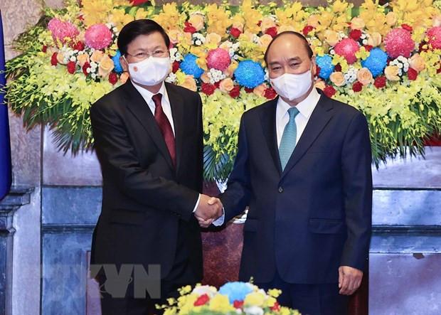 Chuyen tham Viet Nam cua Tong Bi thu, Chu tich Lao: Cot moc lich su hinh anh 2