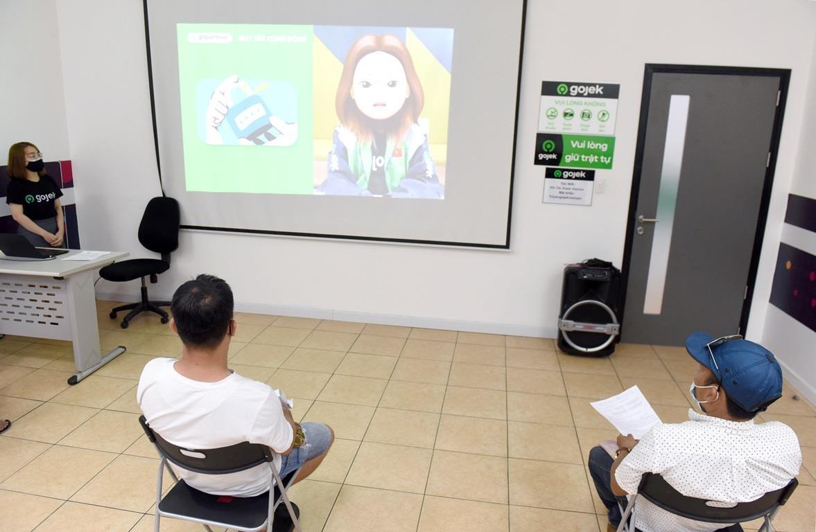 Trước khi trở thành đối tác GoCar chính thức các ứng viên vẫn phải trải qua một lớp học và phải vượt qua bài kiểm tra cuối khoá thực hiện online. (Ảnh: CTV/Vietnam+)