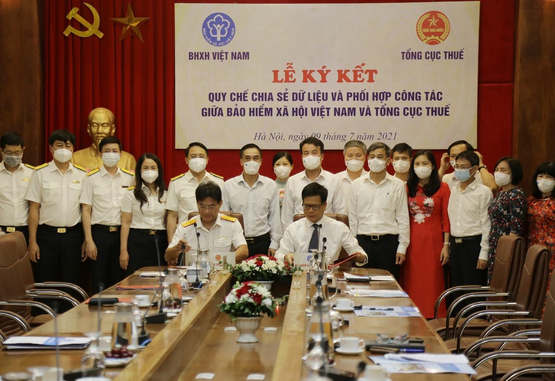 Bảo hiểm xã hội Việt Nam và Tổng cục Thuế ký kết quy chế chia sẻ dữ liệu - 1