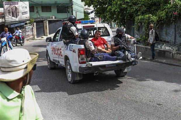 Vu am sat Tong thong: My cu nhan vien thuc thi phap luat toi Haiti hinh anh 1