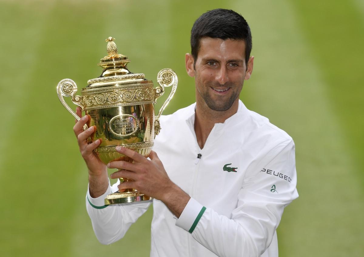 Nole đã có số danh hiệu Grand Slam tương đương Federer và Nadal. (Ảnh: Reuters).