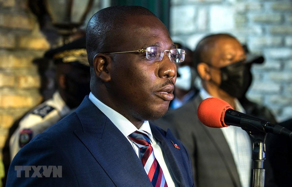 Thủ tướng lâm thời Haiti Claude Joseph trong cuộc họp báo ở Port-au Prince ngày 11/7/2021. (Ảnh: AFP/TTXVN)