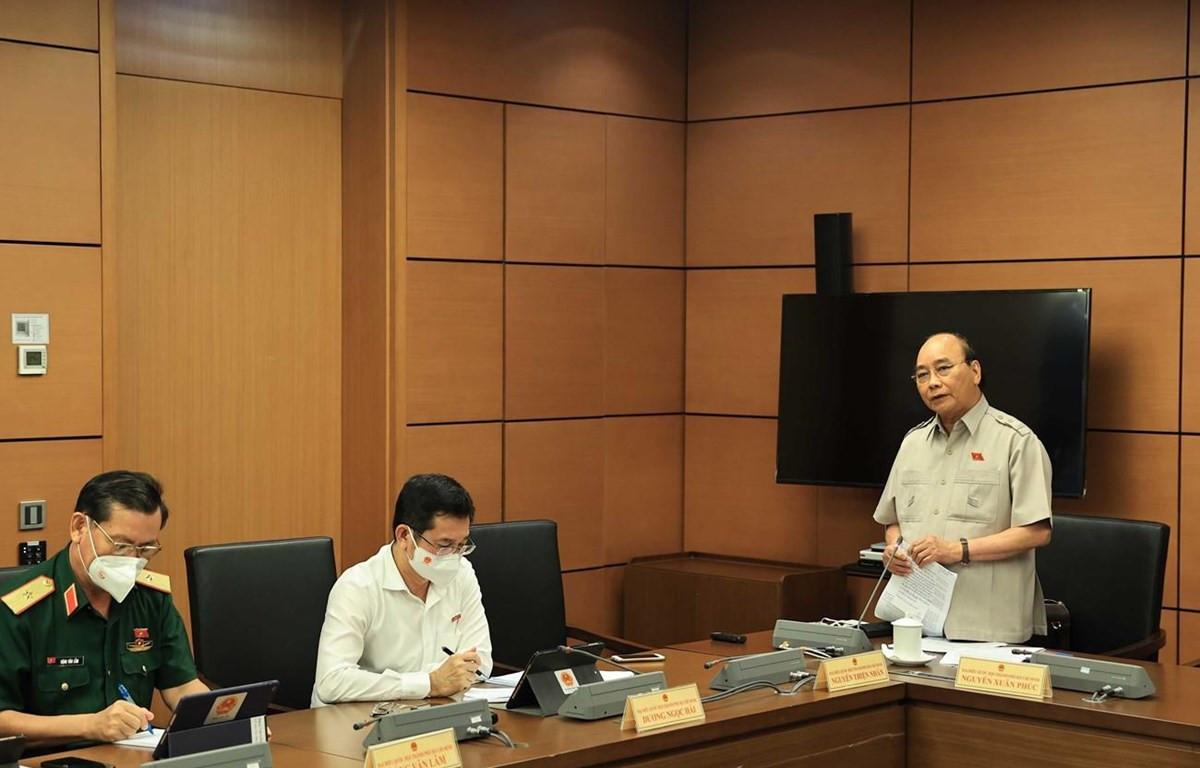 Chủ tịch nước Nguyễn Xuân Phúc phát biểu tại tổ. )Ảnh: Thống Nhất-TTXVN)