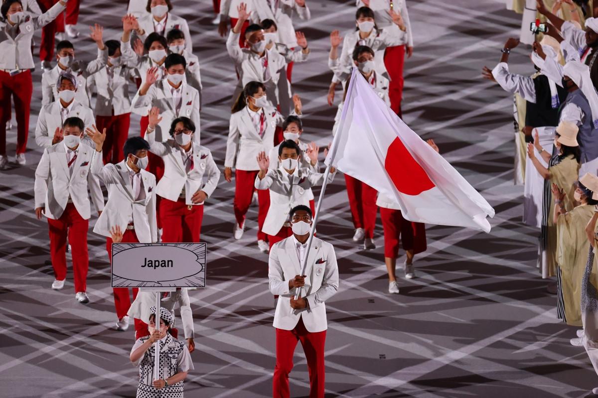 Đoàn thể thao chủ nhà Nhật Bản. (Ảnh: Reuters).