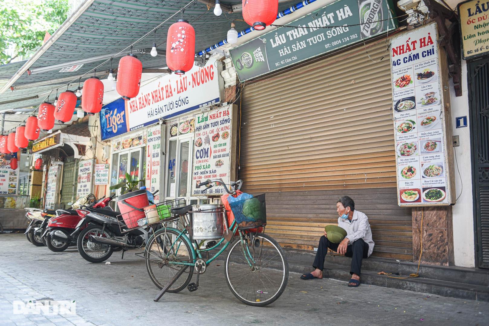 Cảnh cửa đóng then cài, đìu hiu ở phố ẩm thực không ngủ Hà Nội - 10