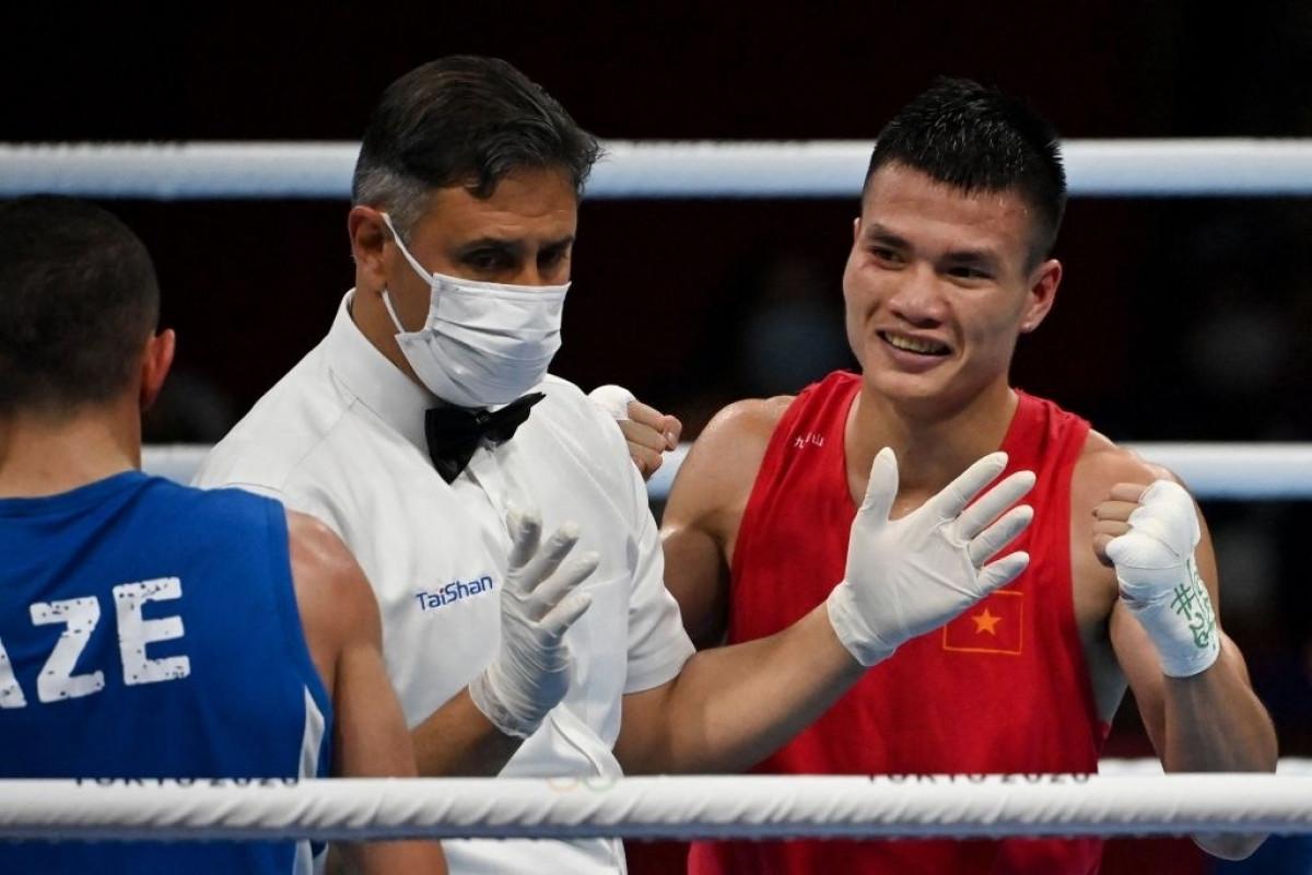 Nguyễn Văn Đương là võ sĩ có vé chính thức đầu tiên của Boxing Việt Nam giành chiến thắng ở đấu trường Olympic. (Ảnh: Getty)