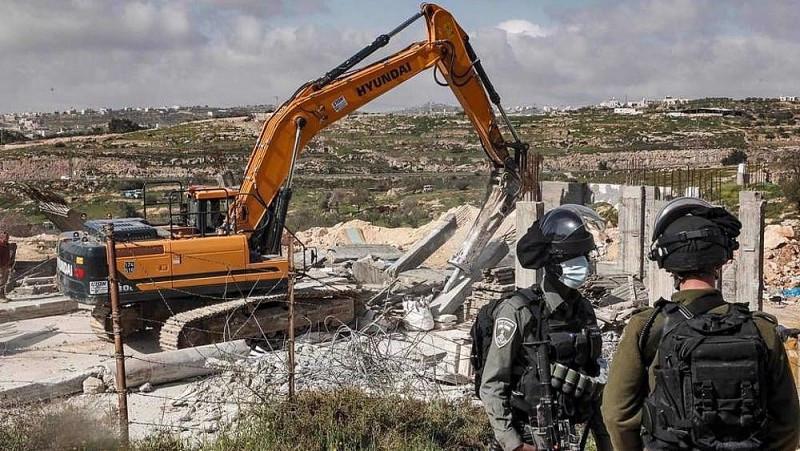 Israel phá dỡ một ngôi nhà của người Palestine ở Bờ Tây hồi tháng 3. Nguồn: AFP)