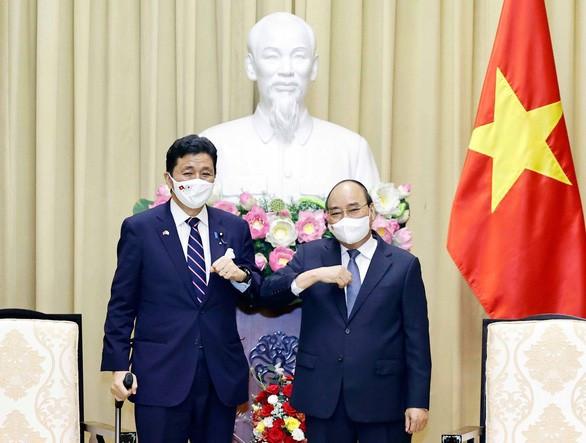 Bộ trưởng Quốc phòng Nhật Bản Kishi Nobuo và Chủ tịch nước Nguyễn Xuân Phúc ngày 12-9 - Ảnh: TTXVN
