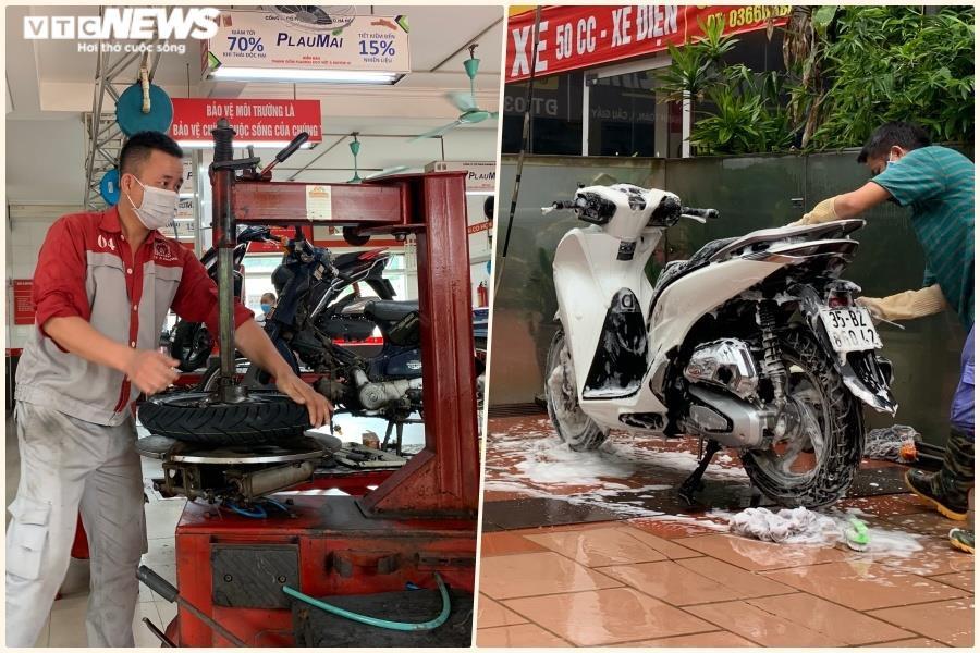 Khách Hà Nội xếp hàng chờ sửa xe, mua phở trong ngày đầu hàng quán mở cửa lại - 1